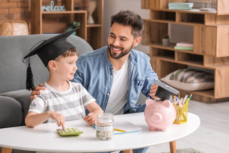 Father following Financial Wellness advice to learn how to save for his son's college education