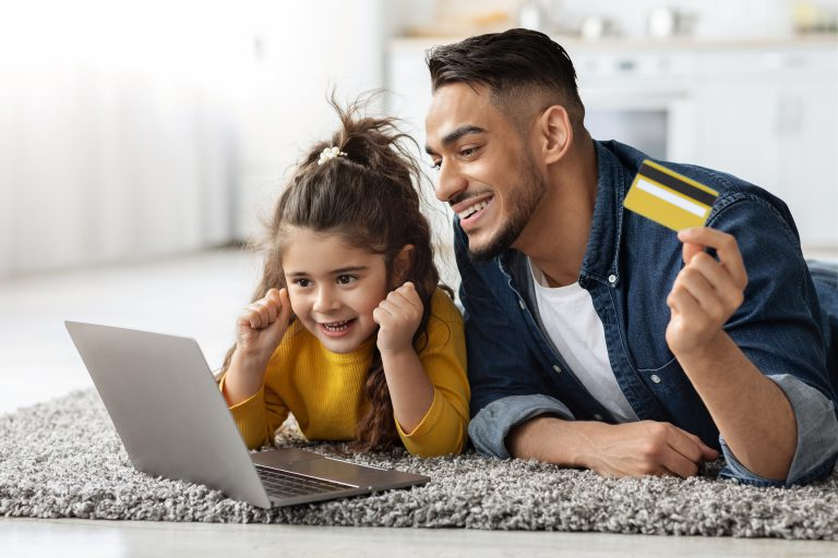 Middle Eastern father making online purchase for daughter