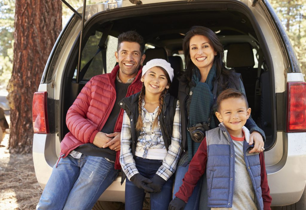Hispanic family on vacation with Safeguard plan protection
